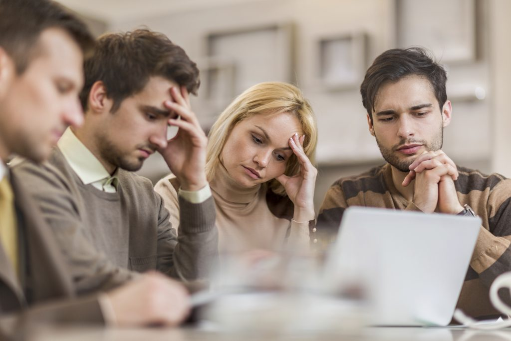 Worried business people working in the office.