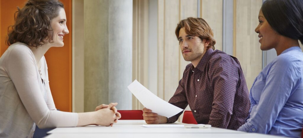 Woman ready for her interview after reviewing common interview questions.
